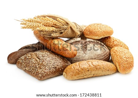 fresh bread and wheat on the white  - stock photo