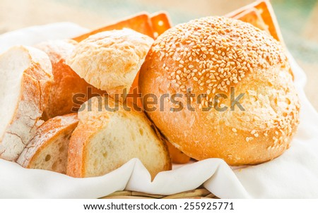 fresh bread and wheat on the wooden backgrounds. - stock photo