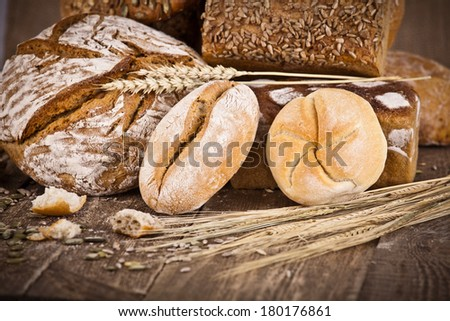 fresh bread and wheat on the wooden - rustic - stock photo