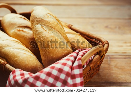 Fresh bread in the basket. Food background. - stock photo