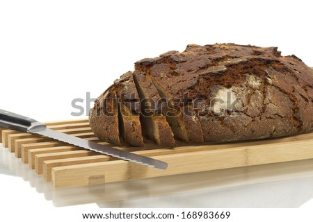 Fresh Bread On A Wood Plate, Isolated Over White Background - stock photo