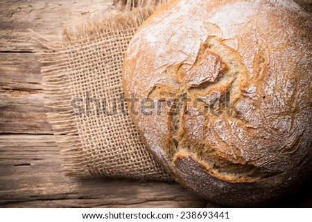 Fresh  bread on a wooden background. Studio photography. - stock photo