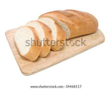 Fresh bread on cutting board - stock photo