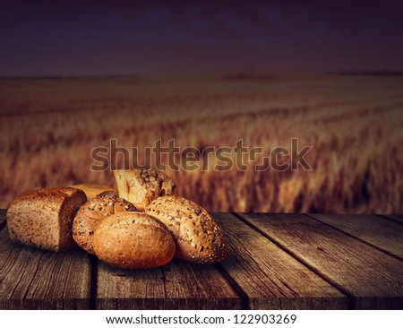 fresh bread on old wooden table of - stock photo