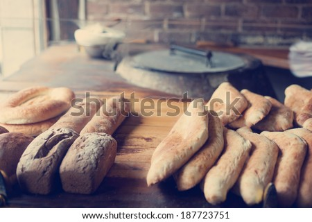 fresh bread on the counter in the store, nashville instagram effect - stock photo