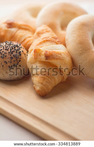fresh bread  on the wood board and white background selective focus