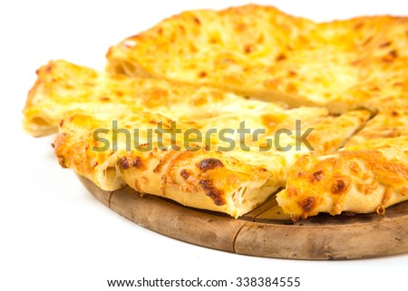 fresh bread with cheese on wooden plate isolated in studio