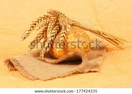 Fresh bread with ears of wheat