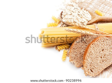 Fresh bread with wheat spikes, oat flakes and macaroni over white - stock photo