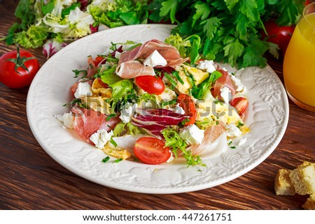 Fresh breakfast Omelette Salad with Parma Ham, feta cheese and vegetables