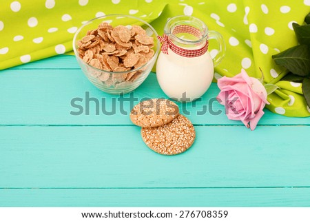 Fresh breakfast with milk, cookies, muesli on blue wooden background. Selective focus.  - stock photo