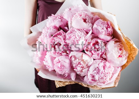 fresh bright blooming peonies flowers with dew drops on petals. white and pink bud. kraft paper. crisp packaging - stock photo