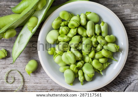 Fresh broad beans - stock photo