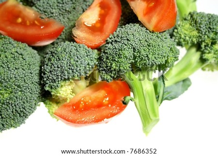 Fresh Broccoli and tomato on a White Background
