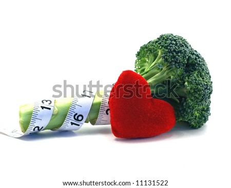 Fresh broccoli healthy heart and lifestyle concept over a white background - stock photo