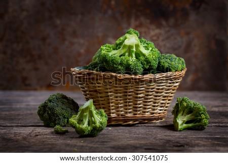 Fresh broccoli in a basket, farm products  - stock photo