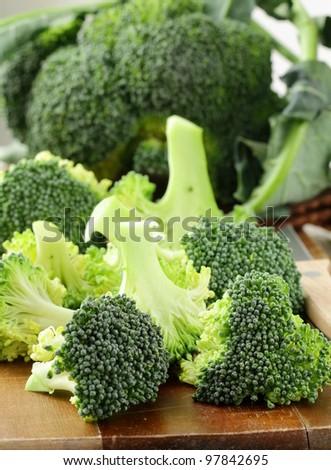 Fresh broccoli on a wooden board - stock photo