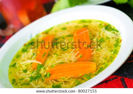 Fresh broth with carrot and parsley - stock photo