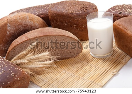 Fresh brown bread with a glass of milk