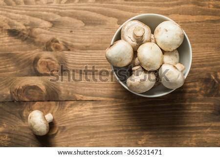 Fresh brown champignon mushrooms / top view  - stock photo