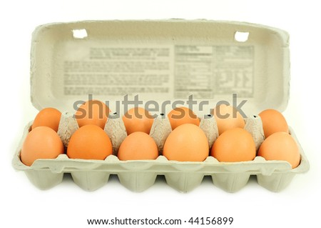 Fresh brown country eggs packaged in a dozen carton - stock photo