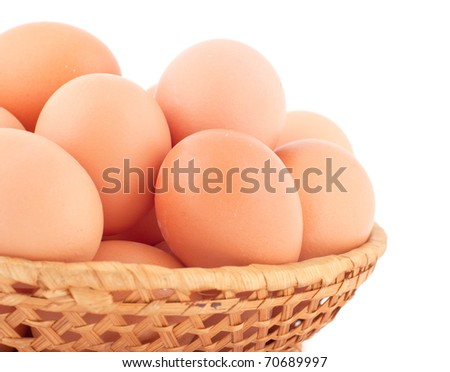 Fresh brown eggs on white background.