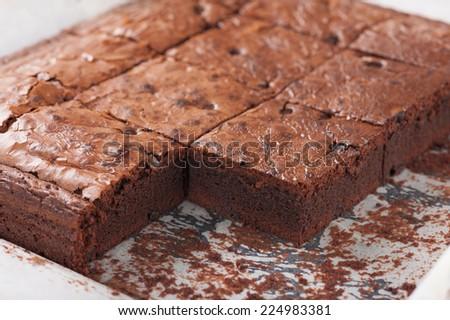 Fresh brownie in tray - stock photo
