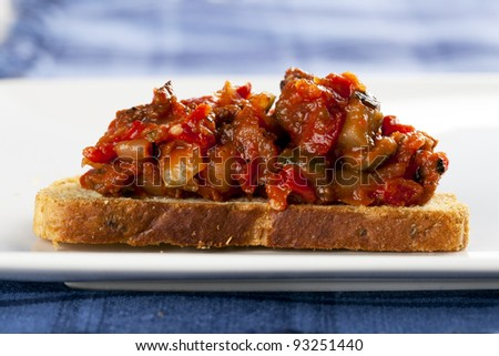 Fresh bruschetta tapas, fresh bread topped with tomato and vegetables. - stock photo