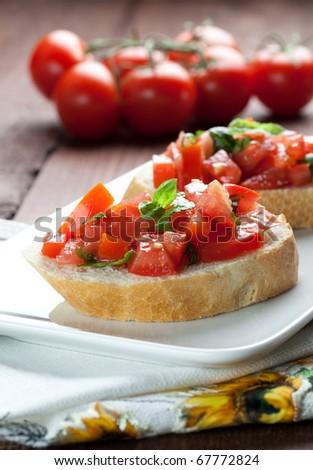 fresh bruschetta with tomato on plate - stock photo