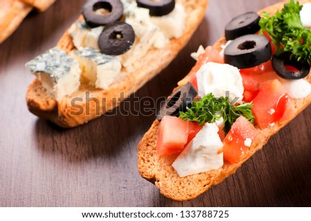 Fresh bruschettas from above. Selective focus on the right bruchetta - stock photo