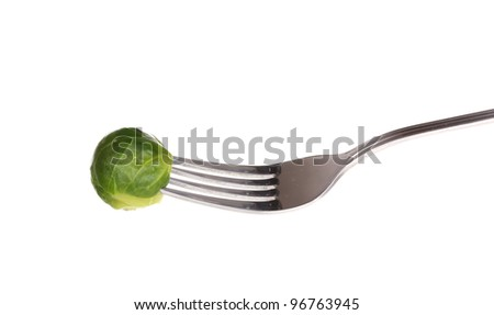 Fresh brussel sprout on fork isolated on white