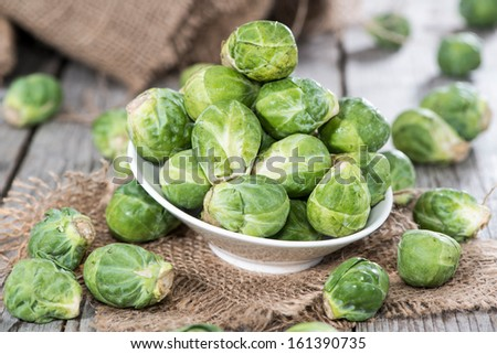 Fresh Brussel Sprouts (macro shot) on rustic background - stock photo