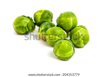 fresh brussels sprouts on white background - stock photo