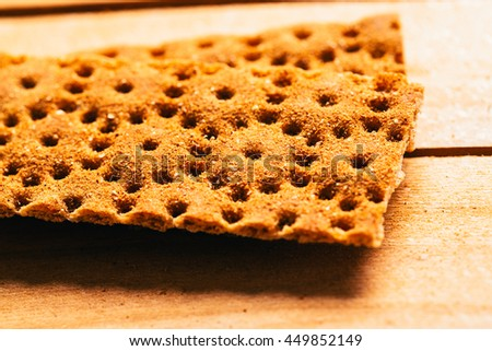fresh buckwheat crackers on a wooden background. - stock photo