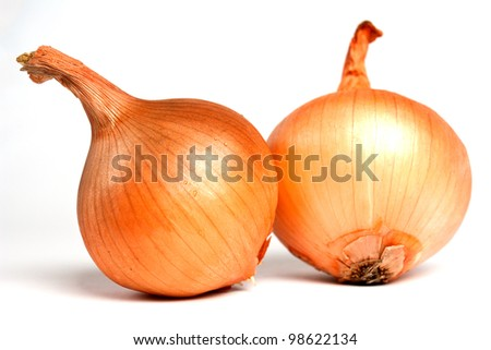 Fresh bulbs of onion not cleared on a white background - stock photo
