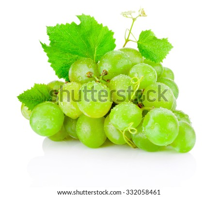Fresh bunch of green grapes with leaves isolated on white background - stock photo