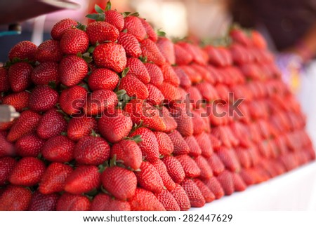 Fresh bunch of vivid strawberries in a market