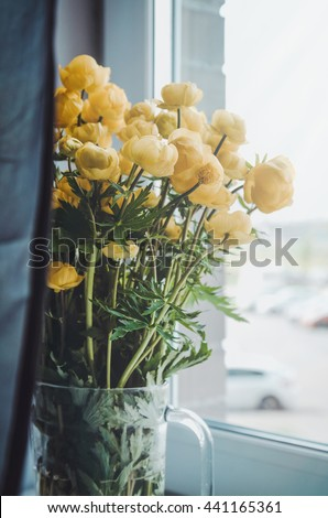 Fresh bunch of yellow summer rose flowers in glass vase on a white windowsill background. Cozy home rustic style decor, still life concept. Village , gardening. Tonal correction filter effect - stock photo