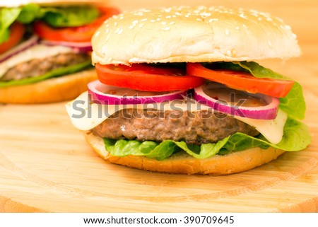 Fresh burger closeup on wooden table