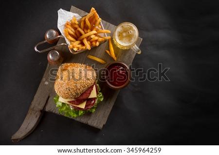 Fresh burger closeup  with cheese and sauce, selective focus - stock photo