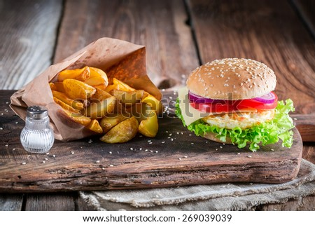 Fresh burger  with fried egg and fries - stock photo