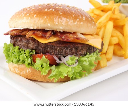 Fresh Burger with ham, cheese, salad and french fries - stock photo
