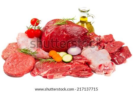 Fresh butcher cut meat assortment garnished  - stock photo