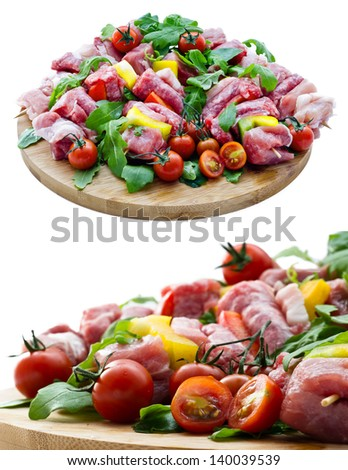 Fresh butcher cut meat assortment garnished on wooden board isolated on white background - stock photo