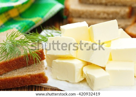 Fresh butter and bread on the table