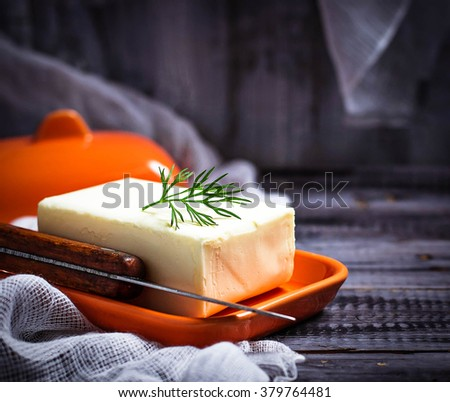 Fresh butter and knife. Selective focus, toned - stock photo