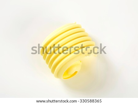 fresh butter curl on white background - stock photo