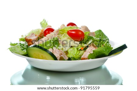 Fresh Caesar salad on a plate with reflection - stock photo