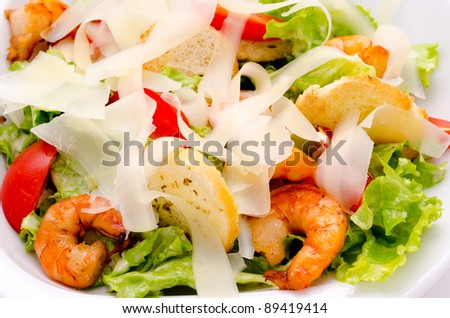fresh Caesar salad with shrimps and tomatoes