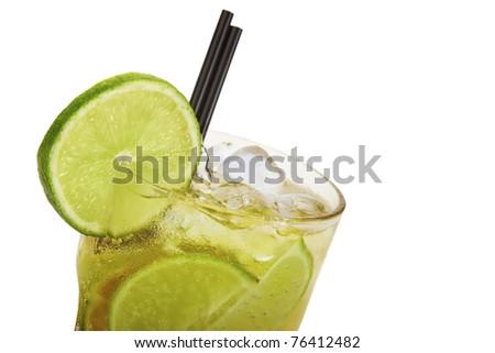 Fresh caipirinha on ice with two drinking straws - stock photo